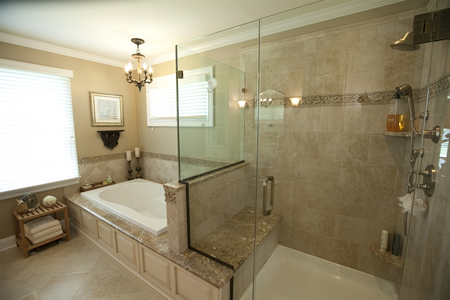 Popular A Lavish Master Bathroom Includes Radiantheated Floors, A Soaking Tub, Frameless Glassenclosed Shower, Dual Vanities With Stone Countertops  Car Ride Or 45