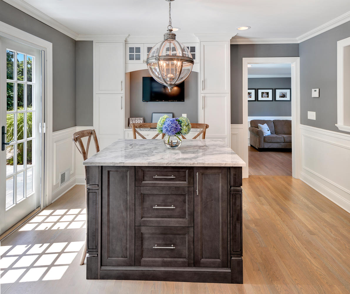 Dark Gray Island And White Cabinets