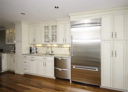 Galley Kitchen With Glass Cabinets